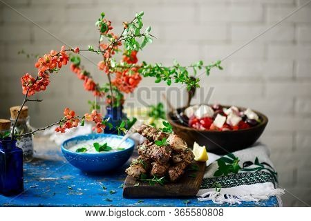 Greek-style  Pork Souvlaki Skewers With  Vegetablessalad.selective Focus