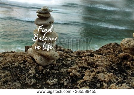 Inspirational Quote - Find Balance In Life. On Background Of Rock Balancing And Calm Wave Water In T