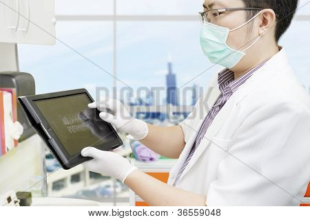 Dentist With Computer Tablet