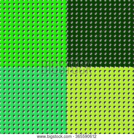 Set Of Different Shades Of Saturated Green Color Perforated Flat Surfaces Of Paper, Plastic, Metal.