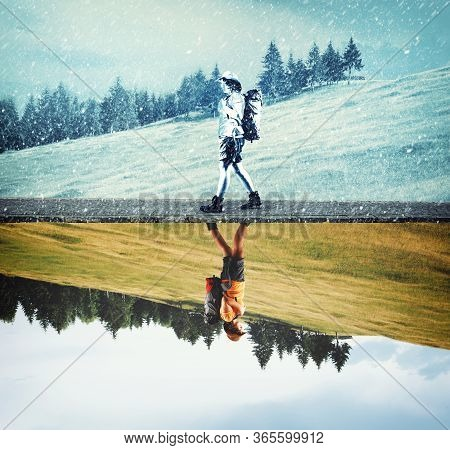 Half Splitted Image Of A Traveler Walking During Winter And Summer . Climate Change Concept .