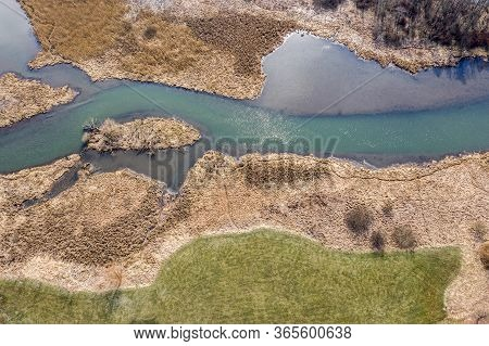 Aerial Drone View Of Winding River In Green Field And Wetlands. Bird's Eye View