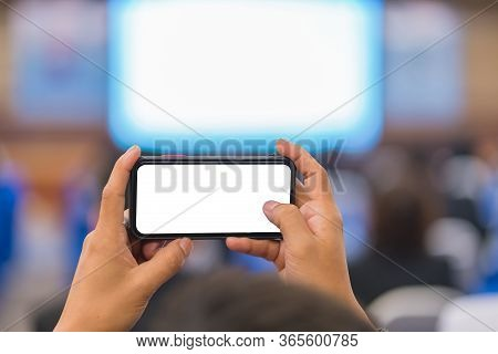Man Taking Photo To Speaker On The Stage Present In Conference Hall Or Seminar Meeting, Event And Se