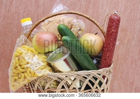 Basket With Food On A Wooden Background. Food Delivery. A Donation Of Food.