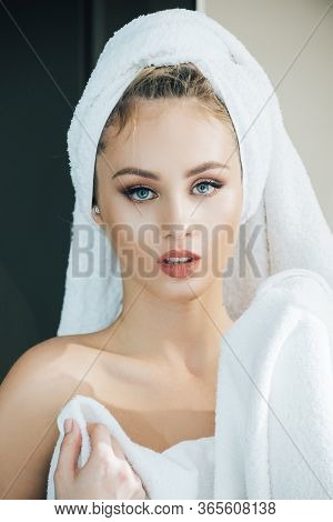 Naked Girl In Towel. Young Woman After Bath Or Shower. Girl Wearing White Towel On Head Holding Hand