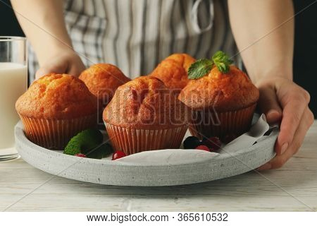 Woman Holds Tray With Muffins, Close Up. Muffins And Milk