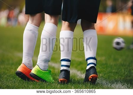 Soccer Free Kick Wall - Close Up Of Players Legs. Two Young Football Players Standing In Wall During