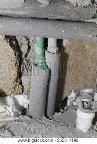 Installation Of Water And Sewer Plastic Polyvinyl Chloride Pipes With Cut Rigid Foam-board Stripe, T