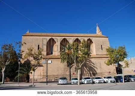 MAJORCA, SPAIN - NOVEMBER 12, 2019: The Church of Sant Jaume in Alcudia Old Town. The Neo Gothic building was completed in 1893.