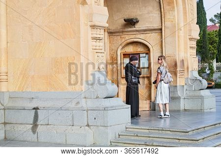 Tbilisi, Georgia - October 21, 2019: Big Orthodox Cathedral St. Trinity Or Chirch Sameba And A Girl