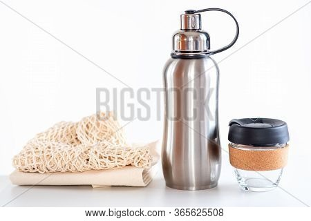 Eco Friendly Shopping Bags, Reusable Glass Coffee Cup, Reusable Water Stainless Bottle On White Back