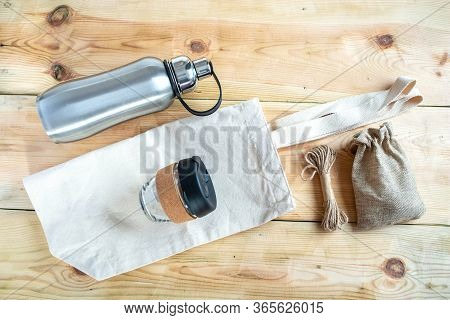 Eco Friendly Shopping Bag, Reusable Coffee Cup, Reusable Water Stainless Bottle And Skein Of Jute Tw