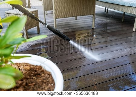 Cleaning Wooden Terrace Planks With High Pressure Washer