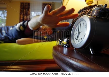 Morning Wake Up In The Bedroom. The Man Sleep And Turns The Alarm Off With His Hand. Early Clock Tim