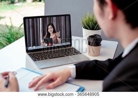 Asian Business Video Conference User Interface On Laptop Computer Online Remotely Working From Home