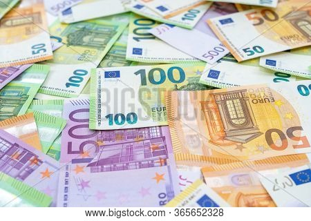European Currenc Lies On The Table. Banknotes One Hundred, Two Hundred, Fifty, Five Hundred Euros Ar