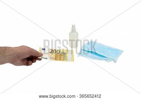 A Hand Buys A Bill Of 200 Two Hundred Euros A Few Blue Medical Surgical Masks And A Bottle Of Antise