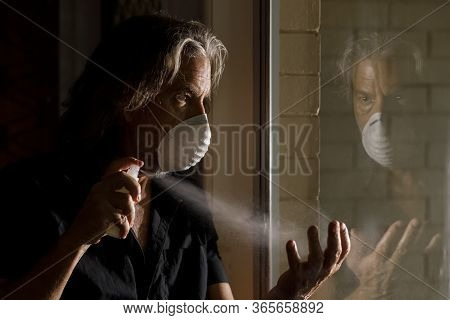 Coronavirus Male Medical Mask Sanitizer Concept, Reflection Of Middle Aged Man In Protective Mask Sp