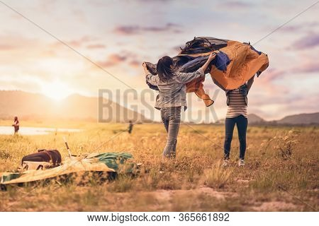 People Pitch A Tent On The Ground Near The Lake. Relaxing, Traveling, Long Weeked, Holiday Concept.