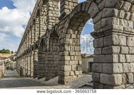 The Famous Roman Aqueduct Of Segovia In Spain. Heritage Of Humanity By Unesco.