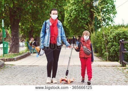 Coronavirus Epidemic. Mother And Son On A Walk During Coornavirus Quarantine. Prevention Coronavirus