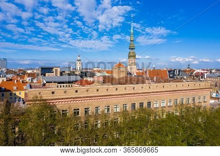 Cityscape Aerial View On The Old Town Of Riga With Rtu Building And St. Peters Cathedral Above Beaut
