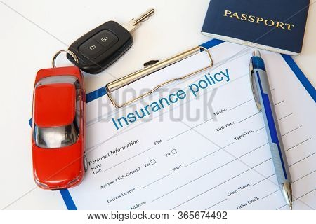 Insurance Concept. Auto Insurance Policy And Other Documents