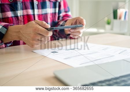 Business Man Using A Mobile Phone To Pay Bills Using Mobile Phone Applications. Online Payment And S
