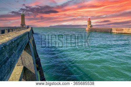 Dramatic Sunset Over The Lighthouses And Guidance At The Entrance Of The Port Of Fecamp, Seine-marit