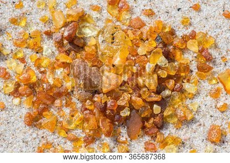 Beautiful Pieces Of Amber On The Sandy Beach, Amber Background