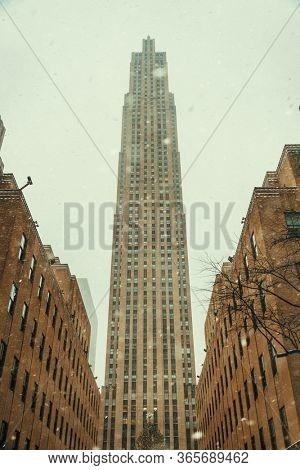 NEW YORK, USA - JAN 13, 2019: New York City Rockefeller building in winter storm