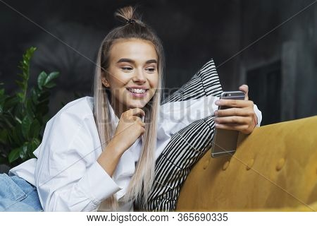 Young Woman Shows Bright Positive Emotions When Communicating, Good News, Surprise, Happiness From I