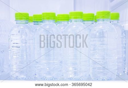 Many Mineral Fresh Drinking Water In Plastic Bottle Freeze In Cooler Shelf Or Refrigerator For Cool