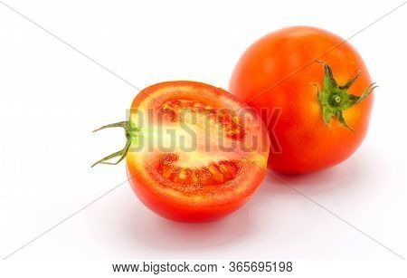 Tomatoes. And A Half Tomato Isolated On White Background