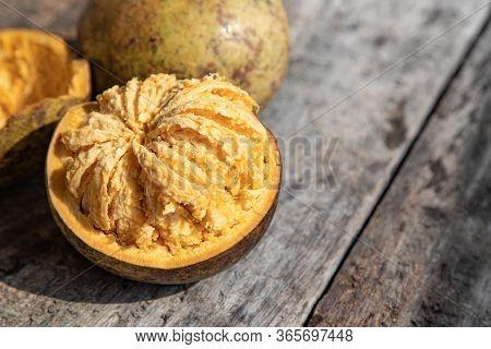 Exotic Indian Bel Fruit Or Wooden Apple. Bel Fruit Slices On Wooden Rustic Background. Natural Detox
