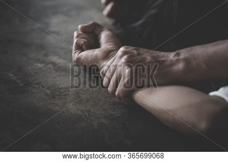 Close Up Of Man Hands Holding A Woman Hands For Rape And Sexual Abuse Concept, Wound Domestic Violen