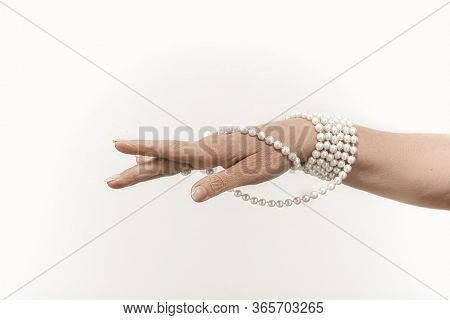 Pearl Necklace On Mature Female Hand, Pretty Womans Naked Hand With French Manicure Holding Pearl Je