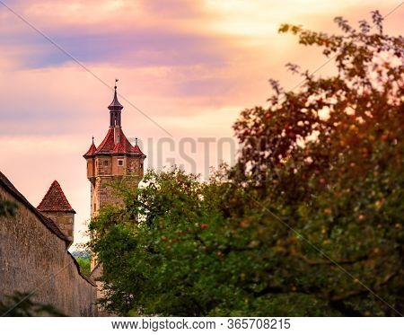 Rothenburg Ob Der Tauber City In Bavaria, Germany, Europe. Tower And Wall With Sunset Sky In Backgro
