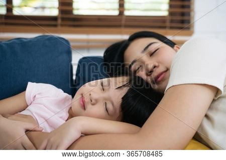 Asian Family Mom And Daughter Napping Sleeping On Sofa In Living Room At Home