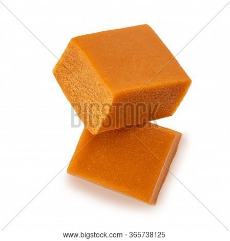 Caramel Candies Isolated On A White Background. Caramel Pieces Close Up