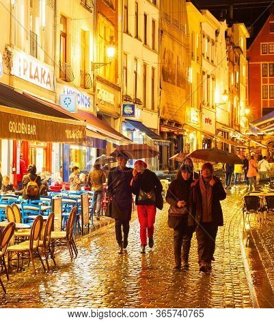 Brussels, Belgium - October 07, 2019: People Walking And Sitting At A Restaurant On Old Town Shoppin