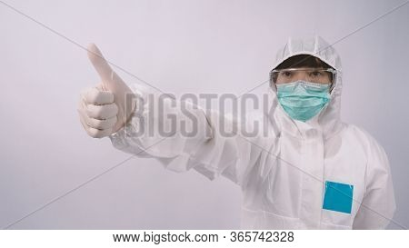 Wide Angle Images Of Asian Woman Doctor In Ppe Suit Showing Thumb Up