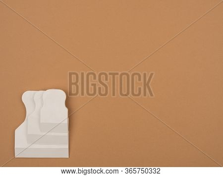Rubber Spatula On A Beige Background. Spatula For Grouting.