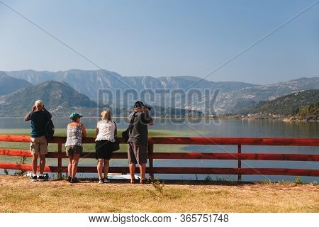 Montenegro, National Park Skadar Lake - September, 21 2018: A Group Of Senior Tourists Looking At A