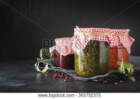 Canned Homemade Sauce For Serving To Meat, Adjika From Tomato, Sorrel, Tkemali From Plum. Homemade P
