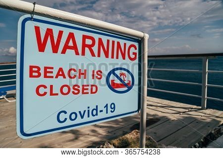 Beach Is Closed Due To Covid-19 Warning Sign At The Entrance To The Beach. Social Media Campaign For