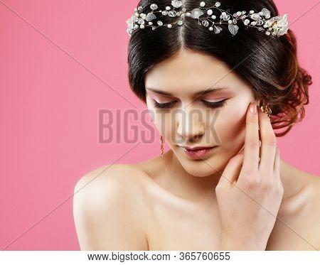 Wedding earrings on a female hand, she takes the earrings, wear earrings.