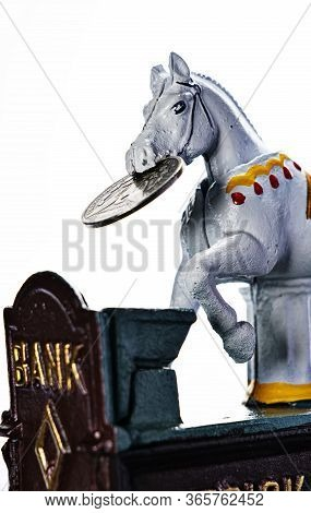 Vintage, All Metal, Hand Painted Trick Pony Coin Bank With A  Silver Mercury Dime, Isolated On White