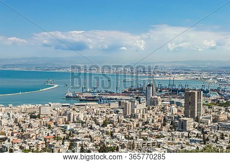 Port City With Infrastructure On A Background Of Mountains And Sea