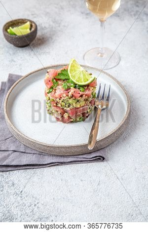 Tuna Tartare Tartar With Avocado And Quinoa. Gourmet Presentation With Culinary Ring On Wite Plate